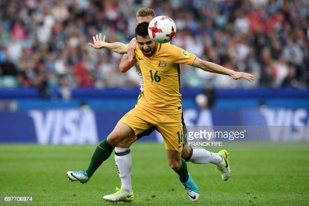 TOPSHOT Germany's defender Joshua Kimmich vies for the ball against Australia's defender Aziz Behich during the 2017 Confederations Cup group B...