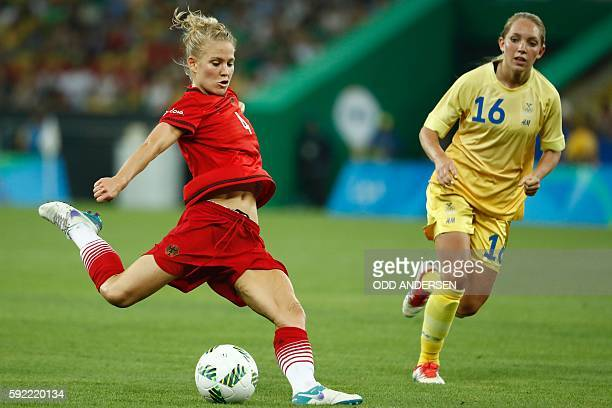 Germany's defender Leonie Maier and Sweden's midfielder Elin Rubensson vie for the ball during the Rio 2016 Olympic Games women's football Gold medal...