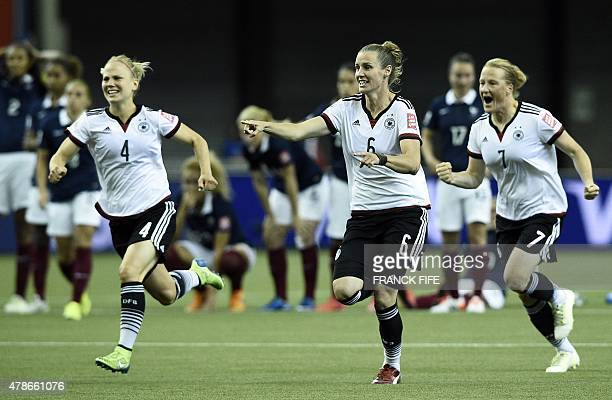Germany's defender Leonie Maier midfielder Simone Laudehr and midfielder Melanie Behringer react after winning the quarterfinal football match...