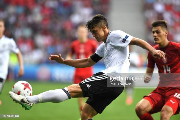Germany's defender MarcOliver Kempf and Czech Republic's forward Patrick Schick vie for the ball during the UEFA U21 European Championship Group C...