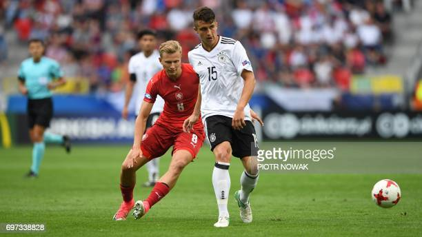 Germany's defender MarcOliver Kempf and Czech Republic's midfielder Antonin Barak vie for the ball during the UEFA U21 European Championship Group C...