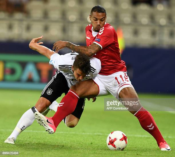 Germany's defender MarcOliver Kempf and Denmark's forward Kenneth Zohore vie for the ball during the UEFA U21 European Championship Group C football...