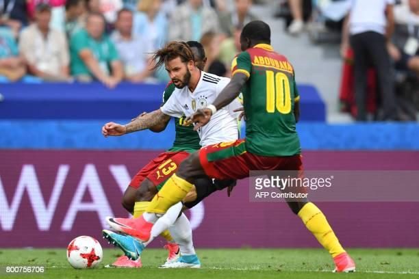 Germany's defender Marvin Plattenhardt challenges Cameroon's forward Christian Bassogog and Cameroon's forward Vincent Aboubakar during the 2017 FIFA...