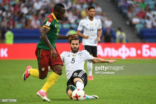 Germany's defender Marvin Plattenhardt challenges Cameroon's forward Christian Bassogog during the 2017 FIFA Confederations Cup group B football...