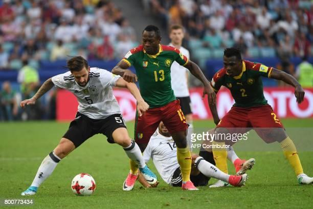 Germany's defender Marvin Plattenhardt challenges Cameroon's forward Christian Bassogog and Cameroon's defender Ernest Mabouka during the 2017 FIFA...