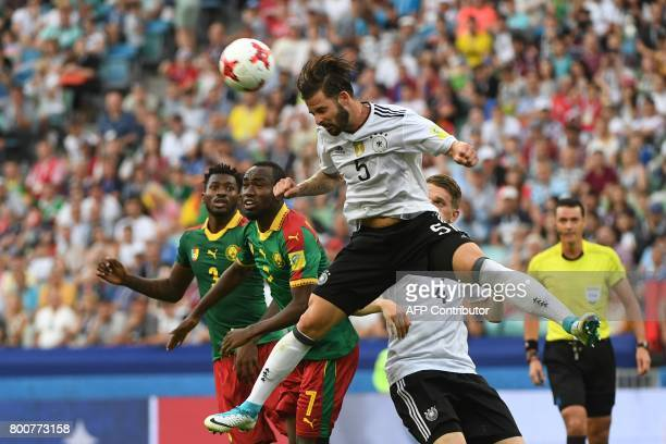Germany's defender Marvin Plattenhardt heads the ball past Cameroon's midfielder Andre Zambo and Cameroon's forward Nicolas Ngamaleu during the 2017...