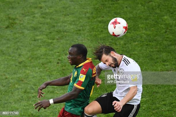 Germany's defender Marvin Plattenhardt heads the ball with Cameroon's forward Vincent Aboubakar during the 2017 FIFA Confederations Cup group B...