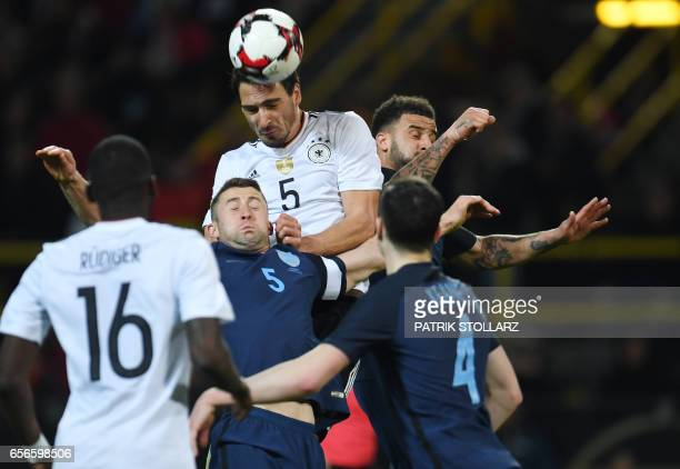 Germany's defender Mats Hummels and England´s Gary Cahill vie for the ball during a friendly football match between Germany and England on March 22...
