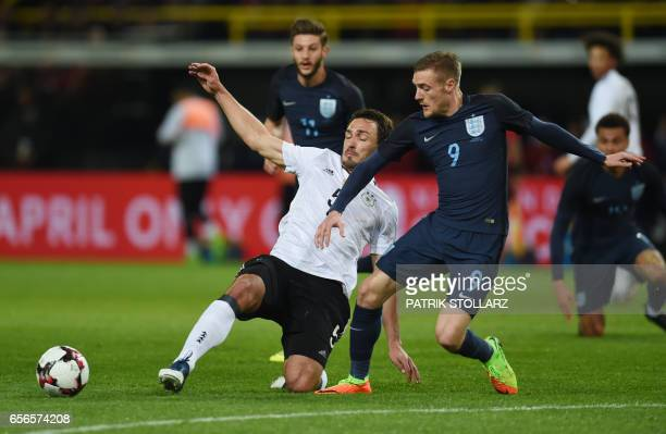 Germany's defender Mats Hummels and England´s Jamie Vardy vie for the ball during a friendly football match between Germany and England on March 22...
