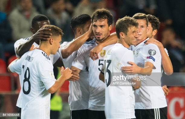 Germany's defender Mats Hummels celebrates scoring with his teammate during the FIFA World Cup 2018 qualification football match between Czech...