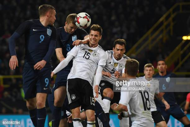 Germany's defender Mats Hummels Germany's defender Julian Weigl EnglanD´s Jamie Vardy and England´s Eric Dier vie during a friendly football match...