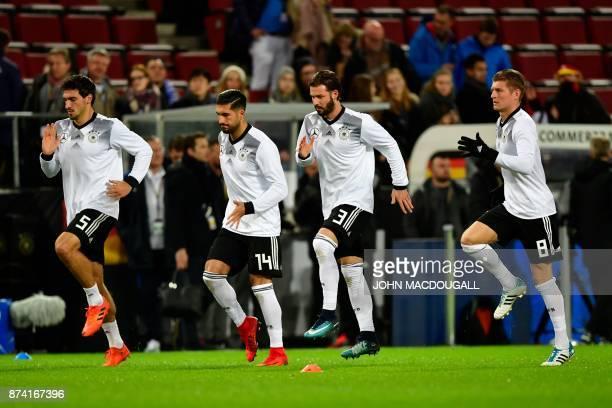 Germany's defender Mats Hummels Germany's midfielder Emre Can Germany's defender Marvin Plattenhardt and Germany's midfielder Toni Kroos warm up...