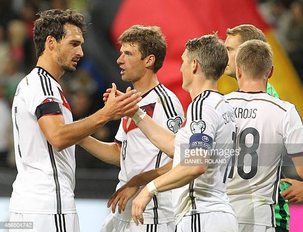 Germany's defender Mats Hummels Germany's midfielder Thomas Mueller Germany's midfielder Bastian Schweinsteiger Germany's midfielder Toni Kroos and...