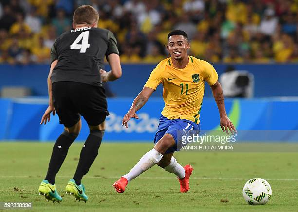 Germany's defender Matthias Ginter vies with Brazil's forward Gabriel Jesus during the Rio 2016 Olympic Games men's football gold medal match between...