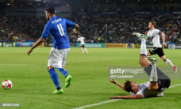 Germany's defender Niklas Stark and Italy's forward Andrea Petagna vie for the ball during the UEFA U21 European Championship Group C football match...
