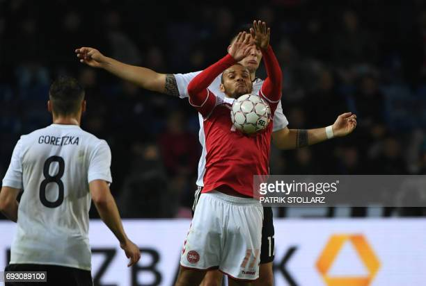 Germany's defender Niklas Suele and Denmark´s Martin Braithwaite vie for the ball during the friendly football match between Denmark and Germany in...