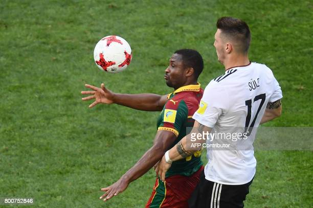 Germany's defender Niklas Suele challenges Cameroon's midfielder Sebastien Siani during the 2017 FIFA Confederations Cup group B football match...