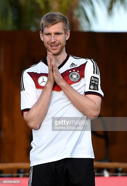 Germany's defender Per Mertesacker gestures during a training session of Germany's national football team in Santo Andre on June 10 2014 ahead of the...