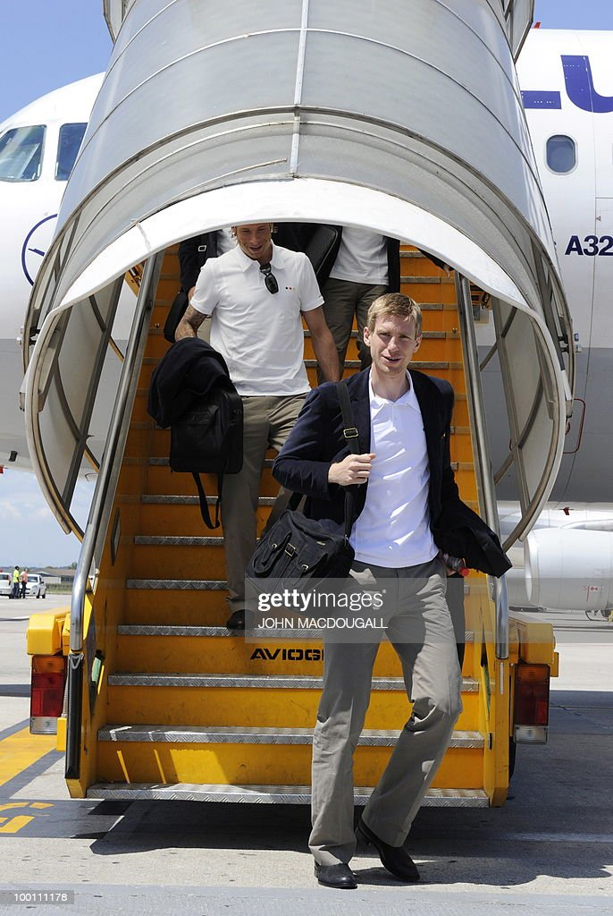 Germany's defender Per Mertesacker gets off the plane in Verona May 21, 2010, as the German team arrives for a 12-day long training camp near Bolzano to prepare for the upcoming FIFA Football World Cup in South Africa.