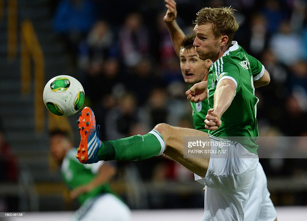 Germany's defender Per Mertesacker scores during the FIFA World Cup 2014 qualifying football match Faroe Island vs Germany in Torshavn on September 10, 2013.