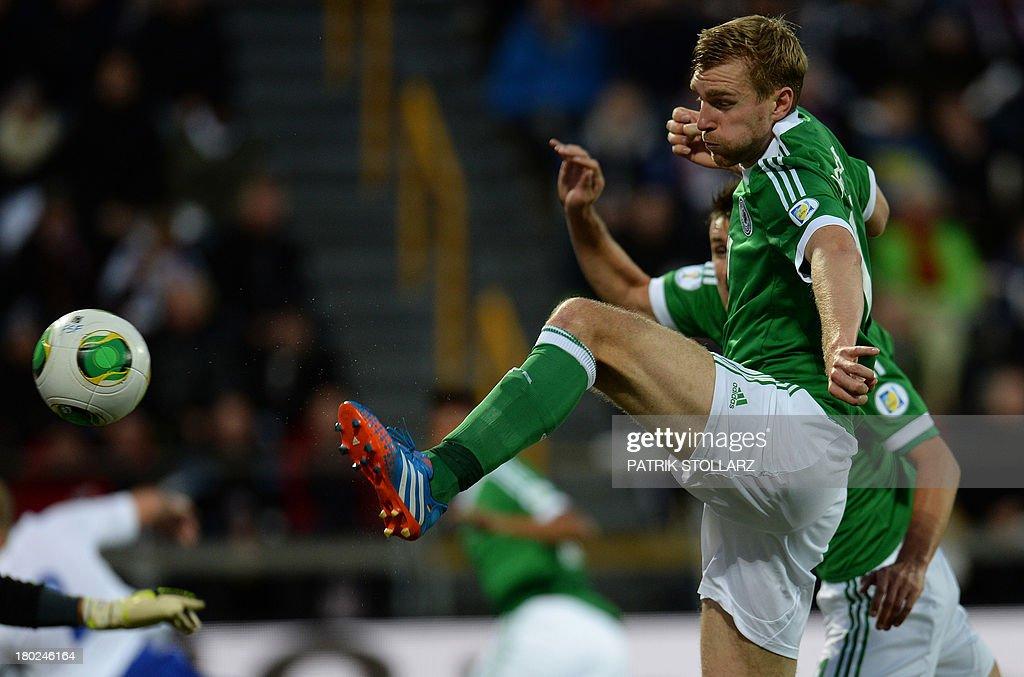 Germany's defender Per Mertesacker scores during the FIFA World Cup 2014 qualifying football match Faroe Island vs Germany in Torshavn on September 10, 2013.
