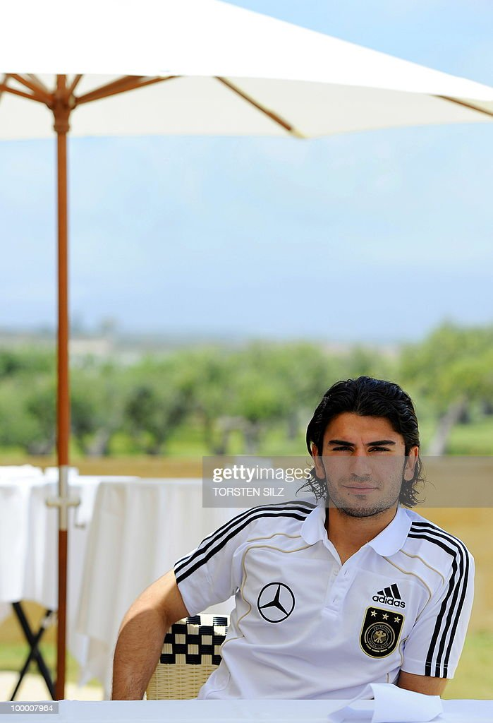 Germany's defender Serdar Tasci speaks to journalists during a so-called media day at the Verdura Golf and Spa resort, near Sciacca May 19, 2010. The German team is currently taking part in a 'Regeneration' camp in Sicily to prepare for the upcoming FIFA Football World Cup in South Africa.