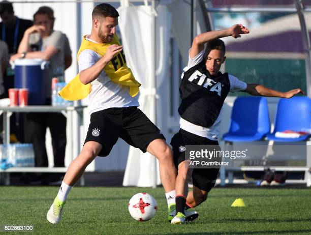 Germany's defender Shkodran Mustafi and Germany's defender Joshua Kimmich attend a training session in Sochi on June 28 2017 on the eve of the Russia...