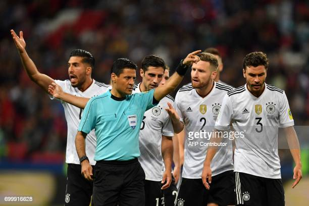 Germany's defender Shkodran Mustafi argues with Iranian referee Alireza Faghani during the 2017 Confederations Cup group B football match between...