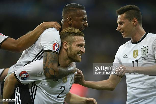 Germany's defender Shkodran Mustafi celebrates with Germany's defender Jerome Boateng and Germany's midfielder Julian Draxler after scoring a goal...