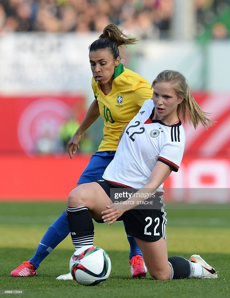 Germany's defender <a gi-track='captionPersonalityLinkClicked' href=/galleries/search?phrase=Tabea+Kemme&family=editorial&specificpeople=4334797 ng-click='$event.stopPropagation()'>Tabea Kemme</a> (R) and Brazil's forward <a gi-track='captionPersonalityLinkClicked' href=/galleries/search?phrase=Marta+-+Soccer+Player&family=editorial&specificpeople=3038337 ng-click='$event.stopPropagation()'>Marta</a> vie for the ball during the friendly women football match between Germany and Brazil in the stadium in Fuerth, southern Germany, on April 8, 2015.
