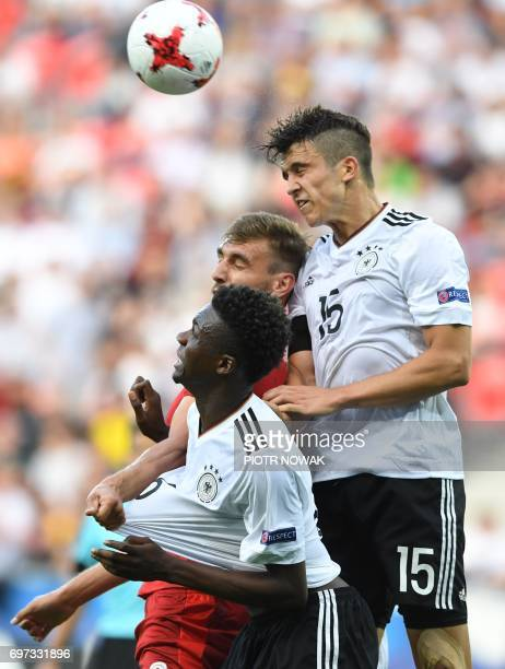 Germany's defenders Gideon Jung and MarcOliver Kempf vie for the ball with Czech Republic's forward Tomas Chory during the UEFA U21 European...