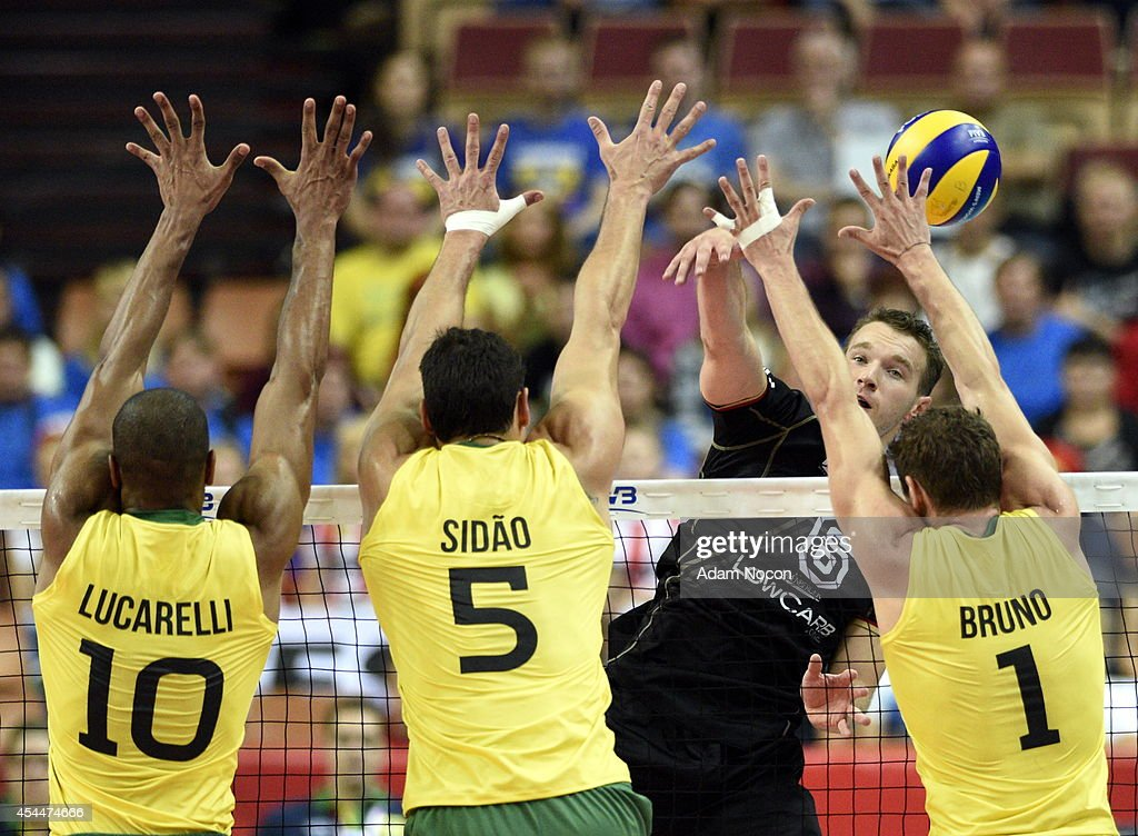 Germany's Denis Kaliberda attacks during the FIVB World Championship match between Brazil and Germany on September 1, 2014 in Katowice, Poland.