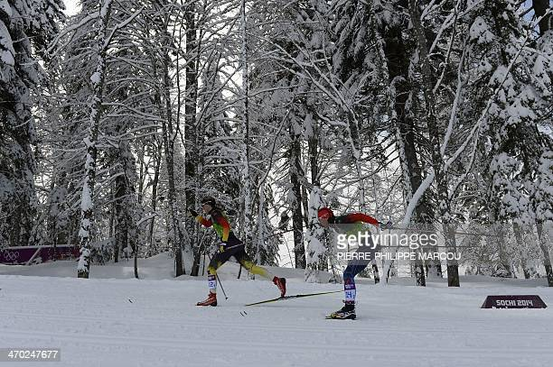 Germany's Denise Herrmann and Russia's Julia Ivanova compete in the Women's CrossCountry Skiing Team Sprint Classic Semifinals at the Laura...