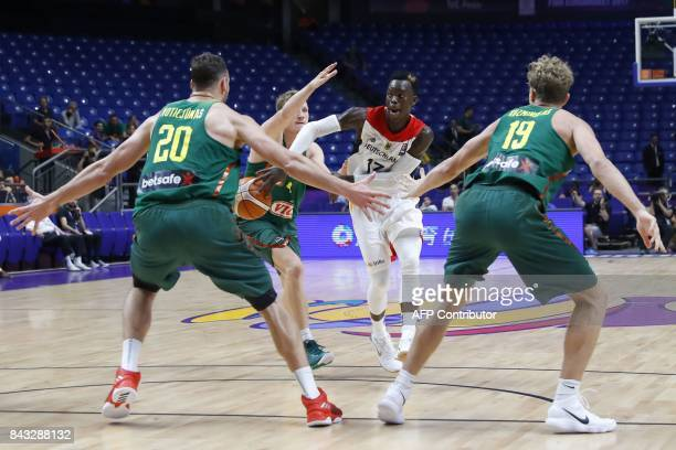 Germany's Dennis Schroder vies against Lithuania's Donatas Motiejunas and Mindaugas Kuzminskas during the FIBA EuroBasket 2017 championship match...