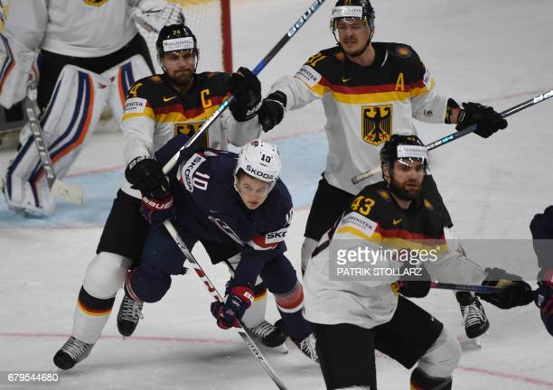 Germany´s Dennis Seidenberg and US Anders Bjork vie for the puck during IIHF Ice hockey world championship first round match between USA and Germany...