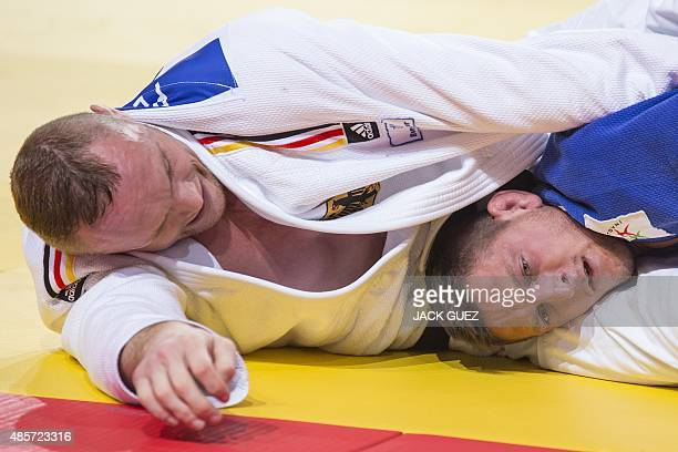 Germanys Dimitri Peters competes with Czechs Lukas Krpalek during the mens bronze medal match in the 100kg category at the Judo World Championships...