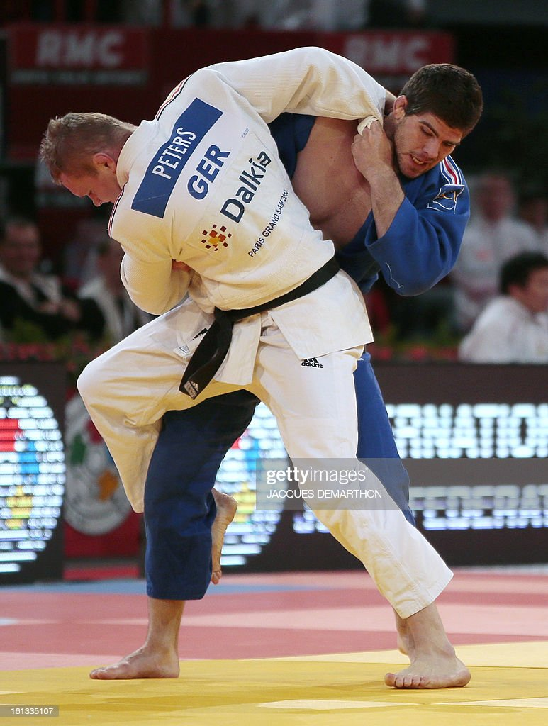 Germany's Dimitri Peters (white) fights against France's Cyrille Maret (blue) on February 10, 2013 in Paris, during the eliminatories of the Men -100kg of the Paris Judo Grand Slam tournament. AFP PHOTO/JACQUES DEMARTHON