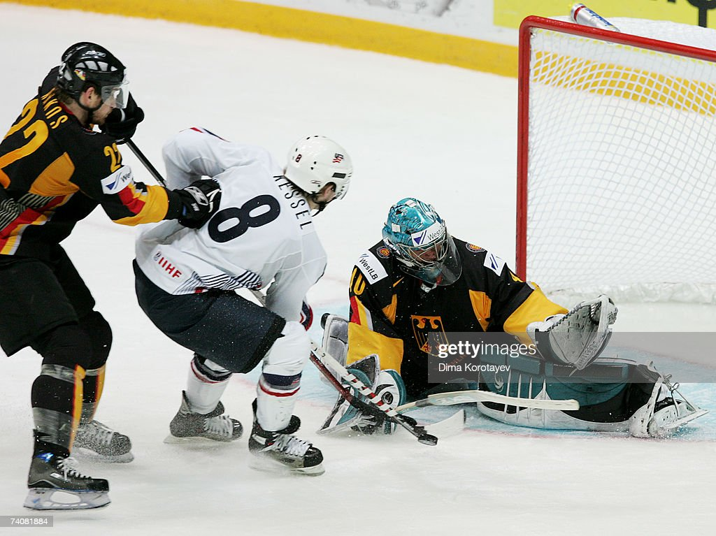 Germany's Dimitrij Patzold and Michael Bakos fights for the puck with USA's Phil Kessel during the IIHF World Ice Hockey Championship qualifying...