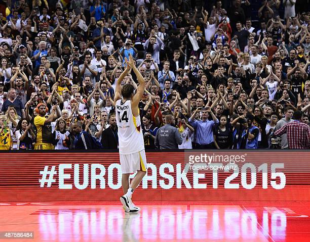 Germany's Dirk Nowitzki cheers to the supporters after the EuroBasket group B match Germay vs Spain in Berlin September 10 2015 AFP PHOTO / TOBIAS...