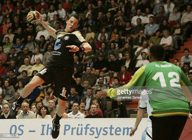Germany's Dominik Klein tries to score during the friendly handball match between Germany and Egypt on January 13 2007 in Munich The match ended 2930
