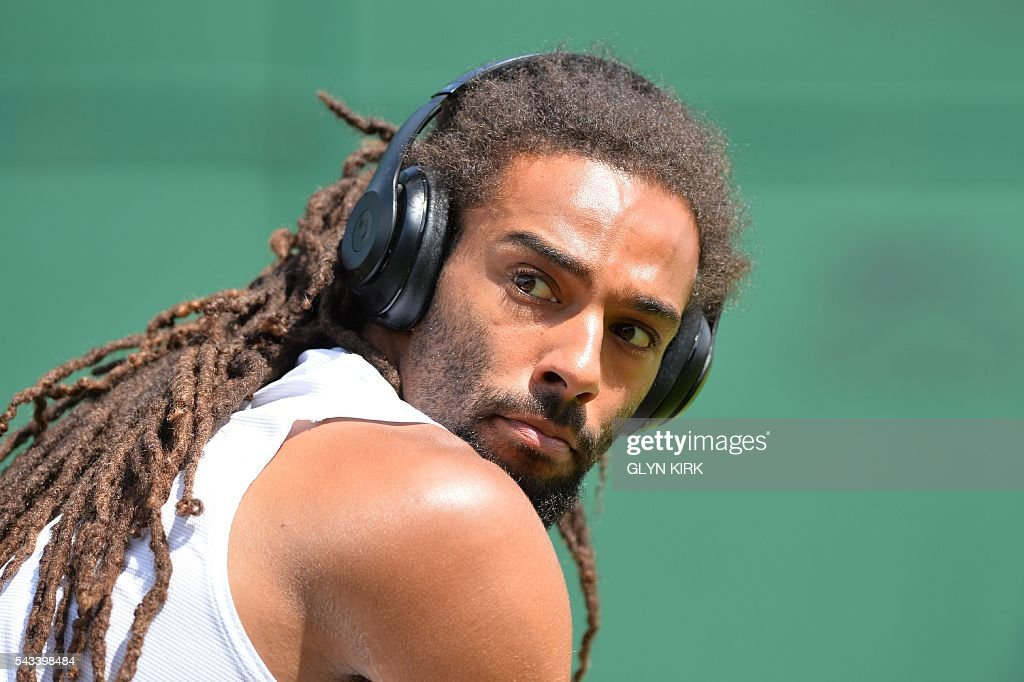 Germany's Dustin Brown prepares to play against Serbia's Dusan Lajovic during their men's singles first round match on the second day of the 2016 Wimbledon Championships at The All England Lawn Tennis Club in Wimbledon, southwest London, on June 28, 2016. / AFP / GLYN