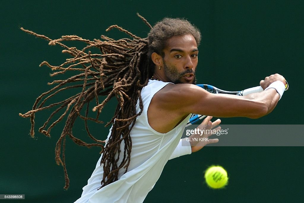 Germany's Dustin Brown returns against Serbia's Dusan Lajovic during their men's singles first round match on the second day of the 2016 Wimbledon Championships at The All England Lawn Tennis Club in Wimbledon, southwest London, on June 28, 2016. / AFP / GLYN