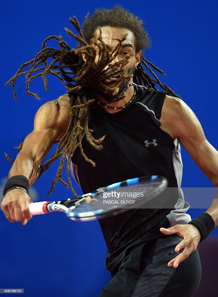 Germany's Dustin Brown returns the ball to France's Richard Gasquet during their semi-final tennis match at the Open Sud de France ATP World Tour in Montpellier, southern France, on February 6, 2016. / AFP / PASCAL GUYOT