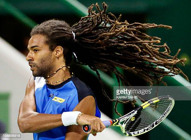 Germany's Dustin Brown returns the ball to Spain's David Ferrer during the 2013 ATP Qatar Open in Doha on January 1 2013 AFP PHOTO/KARIM SAHIB