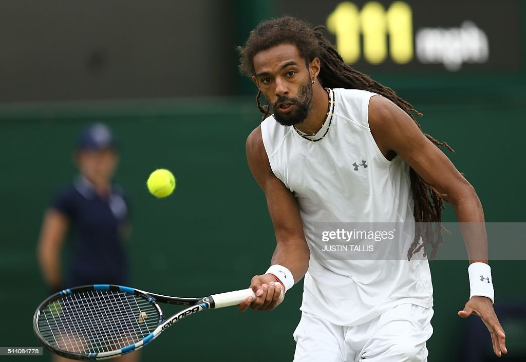 Germany's Dustin Brown returns to Australia's Nick Kyrgios during their men's singles second round match on the fifth day of the 2016 Wimbledon Championships at The All England Lawn Tennis Club in Wimbledon, southwest London, on July 1, 2016. / AFP / JUSTIN