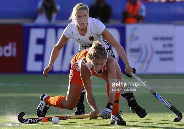 Germany's Eileen Hoffmann vies for the ball with Netherlands' Wieke Dijkstra during the Women World Cup 2010 field hockey Group A match in Rosario...