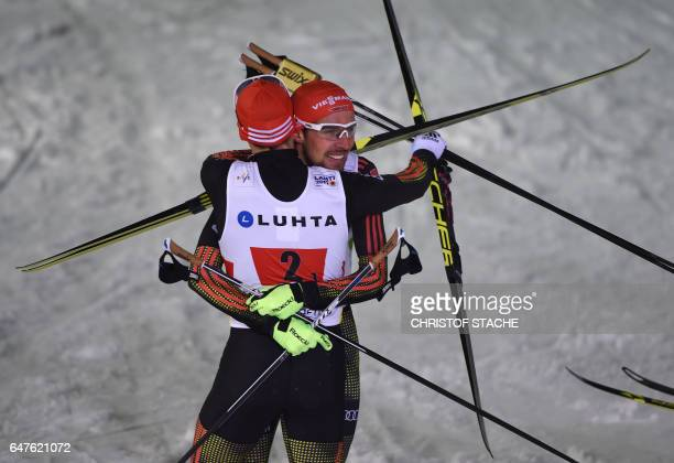 Germany's Eric Frenzel and Johannes Rydzek celebrate after winning the Nordic Combined team sprint competition of the FIS Nordic World Ski...