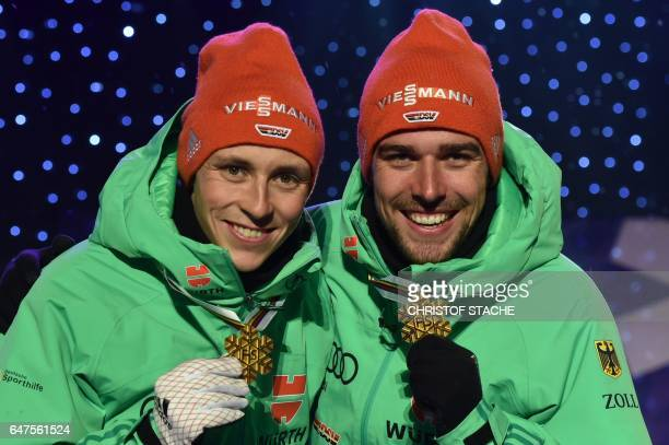 Germany's Eric Frenzel and Johannes Rydzek celebrate during the medals ceremony for the Nordic Combined team sprint competition of the FIS Nordic...