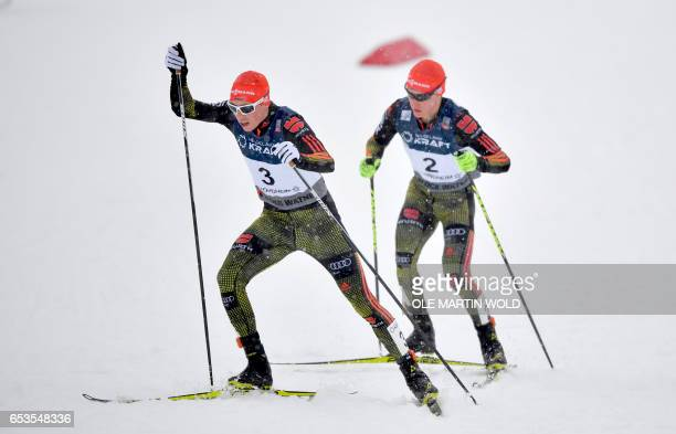 Germany`s Eric Frenzel and Manuel Faisst compete in the FIS Nordic Combined World Cup cross country skiing in Trondheim on March 15 2017 / AFP PHOTO...