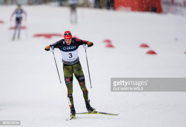 Germany`s Eric Frenzel competes in the FIS Nordic Combined World Cup cross country skiing in Trondheim on March 15 2017 / AFP PHOTO / NTB scanpix AND...